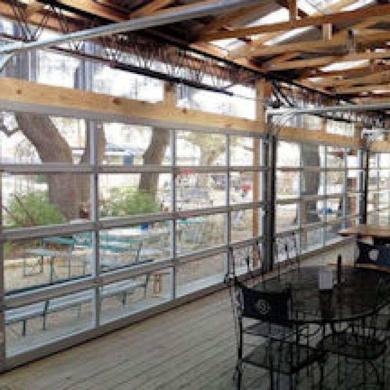 The best glass garage doors for restaurants home owners for Home advisor garage door repair