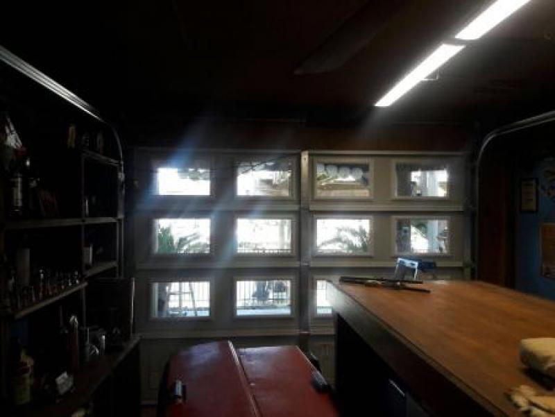Trendy glass garage doors for a full view home owners for Home advisor garage door repair