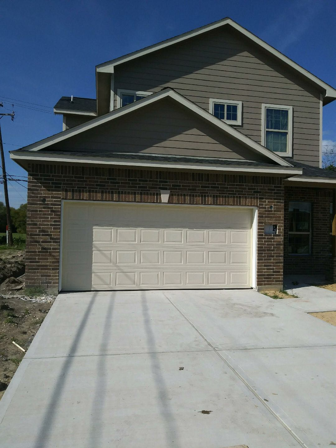 Residential garage doors attached to the home